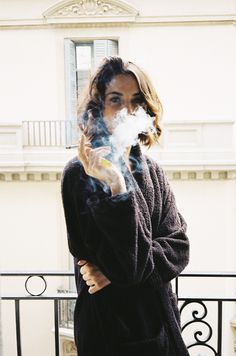 THIS WOMAN, i don't know why. she doesn't give a fuck i think CAUSE OF CIG but shut up.