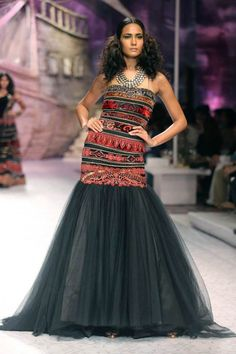 Model walks the ramp in black ensemble designed by JJ Valaya at the Aamby Valley India Bridal Fashion Week. #Bollywood #Fashion