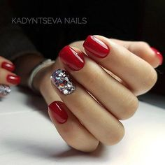Red Nails with Glued On Crystals