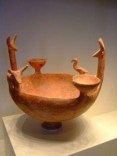 Red polished terracotta ware bowl with cattle and a vulture, by the Philia culture (or Philia group), who existed on the island of Cyprus in the Middle and Late Bronze Age, between 2400 and 1600 BC.
