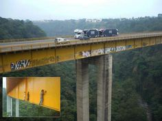 Graffiti artists brave a narrow ledge 430' off the ground to create their work of art on the Metlac Bridge in Veracruz, Mexico (see inset).  If you click on the link, there is video footage of them in action.
