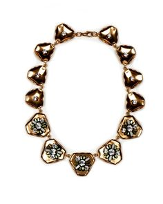 Cottrell Necklace from Nicole Romano. Bring your style to full bloom.   Vintage triangular petal plates, Swarovski crystals and vintage glass baguettes Lobster claw closure. $350