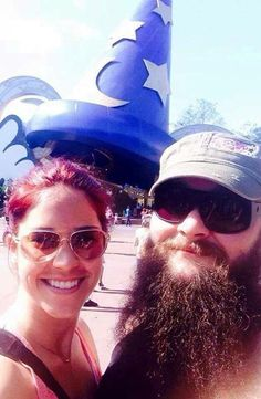 WWE Superstar Bray Wyatt (Windham Rotunda) and his wife Samantha at an amusement park