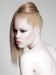 Gert Johan Coetzee, one of the most prominent South African fashion designers, followed suit by presenting an albino model as the face of his new collection.