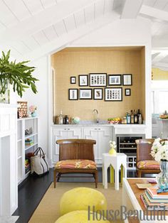 Grass cloth makes a chic backdrop for family photos above the wet bar.