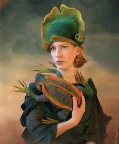 by Pocs Judit. Just curious...when you wear the hat do you have to wear the frog, also?