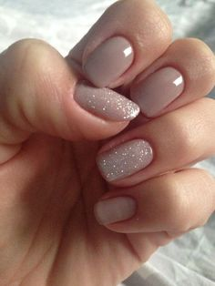 neutral nails with tro glitter ones for an accent More