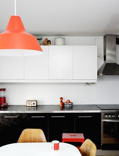 lower black cabinets, upper white cabinets