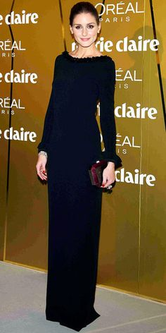 Olivia Palermo in a Christian Dior gown at the Marie Claire Prix de la Moda Awards 2012 in Madrid. She accessorized with Carrera y Carrera jewelry and a maroon clutch.