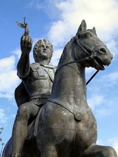 Statue of Alexander the Great riding Bucephalus and carrying a winged statue of Nike (square of Alexander the Great) in Pella city Macedonia Greece, Alexander's birth place.