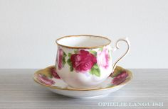 Stunning shabby chic tea cup and saucer featuring a light and dark rose motif against a white background. Elegant gold trim and scalloped edges in the Hampton style. A must have for any shabby chic tea cup collector! English Roses, Old English, Hampton Style, China Patterns, Cottage Chic, Drinkware, Cup And Saucer, Light In The Dark, The Hamptons