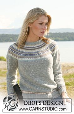 DROPS jumper in Alpaca with round yoke and multi coloured pattern. Long or short sleeves. Size XS - XXL. Free pattern by DROPS Design.