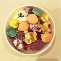 Coconut and green tea frozen yogurt with copious toppings including mini macarons and lychee balls!