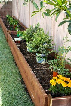 on vegetable garden against fence raised beds designs.html