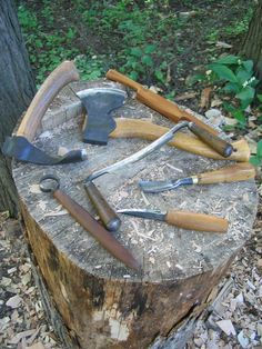 Some of my bowl-carving tools. Beginning at the upper-left and going clockwise, they are the bowl adze, carving axe, spokeshave, drawknife, bent gouge, sloyd knife, and scorp.