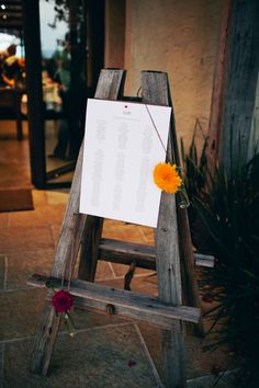 Seating chart displayed on a wooden easel // photo by LoveKatieAndSarah.com