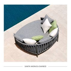 Turn your outdoor space into a resort-style paradise with the new Santa Monica daybed. It is stylish and inviting, with rounded forms and elegant tapered legs.