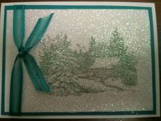 This card was made by stamping an image on white card stock. Then using spray glue, attach a used dryer sheet on top of the image. While the glue is still damp, shake glitter all over the image and rub it in with your finger.