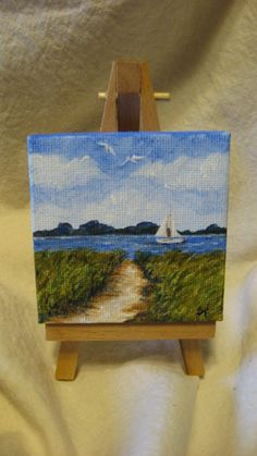 This is an original acrylic painting on a mini canvas(measures 2-3/4 x 2-3/4).The easel IS included with this purchase. The painting goes around
