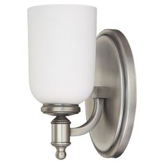 Metal wall sconce in antiqued nickel with a frosted glass shade.   Product: Wall sconceConstruction Material: M...