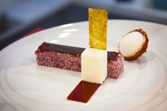 """""""Lamington."""" A soft, raspberry-flavored spong cake -- rolled in desiccated coconut and topped with a paper-thin sheet of raspberry jelly. Plated with a lychee marshmallow, lychee parfait and coconut nougatine."""