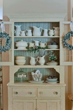 My colors - .painted vintage cupboard filled with stoneware collection