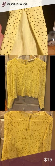 Zara blouse All yellow blouse with small heart prints. Small bottom on top back , long sleeve with zipper on the cuffs. Loose on the bottom. Zara Tops Blouses
