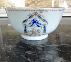 Beautiful 18th century Chinese export armorial  cup with matching saucer from estate of Roger Ward Babson.