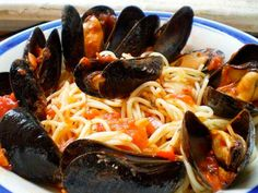 my idea of heaven...mussells in a spicy red sauce