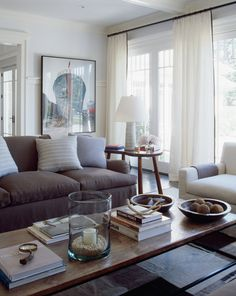 Modern Chic Living Room by Robert Stilin | neutrals + layers | great coffee table styling