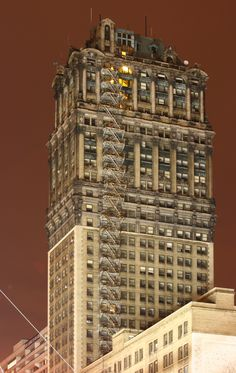Book tower, 9th highest building in Detroit. Completely abandoned, oddly, the light in one staircase remains on.