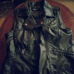 Leather jacket. Zip up. With bronze buttons. No sleeves and in great condition. New Look Jackets & Coats