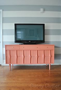 Classy Clutter: Coral and Gold TV Console, grey striped walls. mildly obsessed.