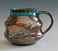 ceramics - I really don't like the glaze or handle, but love the curves in the form of the cup