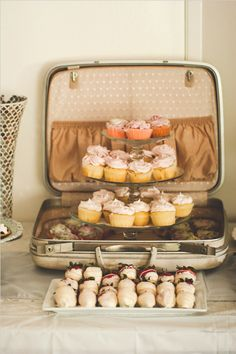 cupcakes in suitcase...not sure how well they'd travel, but they look great! Perfect for a bachelorette tea party.
