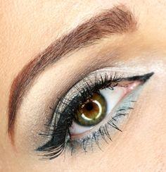 Subdued. https://www.makeupbee.com/look.php?look_id=98272