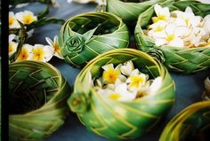 Woven coconut palm frond bowls, complete with plumeria blossoms. This is so gorgeous. Follow my board for more Fiji wedding inspiration.