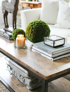 Love the basket underneath and the layout of the coffee table decor on top