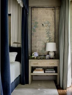 beautiful navy velvet bed drapes  (awesome night stand)