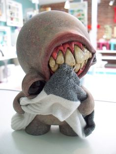 Mouth munny. False nails for the teeth and air dry clay or sugru for the lips, also use latex for texture.