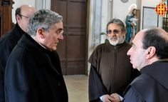 El Cardenal amb el rector i el vicerector de la basílica