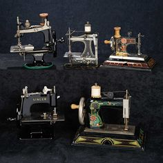 Theriault's. A stunning collection of five toy sewing machines of tinplate, metal, or cast iron. The toy sewing machines function and have been well preserved with their original finish and stenciled designs. Upcoming at Theriault's Stein am Rhein auction on March 29th and 30th, 2014 in Naples Florida.   For more info please visit: http://www.theriaults.com/