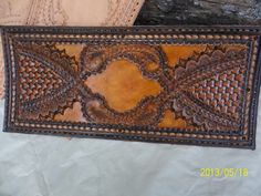 Hand Tooled Leather Monogrammed Tri-Fold Wallet by POPSLEATHERSHOP on Etsy https://www.etsy.com/listing/151114859/hand-tooled-leather-monogrammed-tri-fold