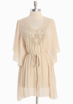 """Ethereal and delicate, this light beige tunic features draped chiffon sleeves with soft pleating and a crocheted applique detail. Finished with a braided waist-defining sash.     100% Polyester  Imported  30.5"""" length from top of shoulder  $43.99"""