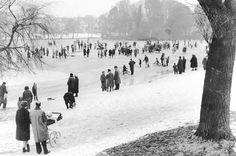 Families walk on the frozen Roath Park Lake during the big freeze of 1963 Wales Uk, South Wales, Big Freeze, Big Lake, Green Fields, Cymru, Rural Area, Cardiff, Old Skool