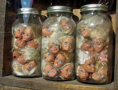 "Jars filled with Barbie Heads. Original source link.: I'd have to ""mess them up"" a bit before I put them in the jar....."