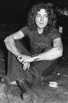 robert plant... (oh just look at those heels! o my.. only a real man could um.. pull those off? idk.. he can though)