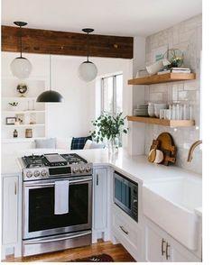 white open kitchen + floating wood shelves