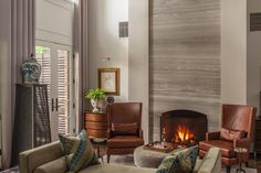 Fantastic and unique contemporary fireplace design.  From 1 of 27 projects by Wentworth Studios.