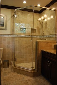 Love this large corner custom ceramic tile shower with all the glass.